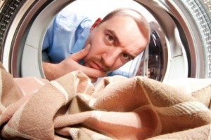 Man laundry fabric thinking