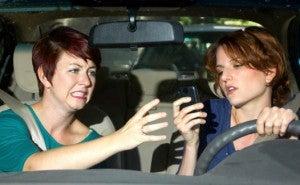 Woman driving texting
