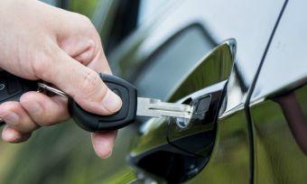 Individual unlocking car with keys