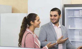Couple looking at fridge