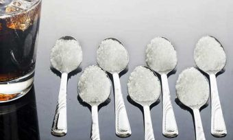 Seven spoons of sugar with soft drink