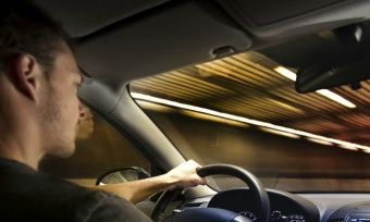 man driving in tunnel