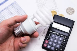 Light bulb with calculator and coins