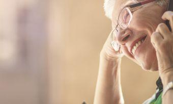 smiling senior on phone