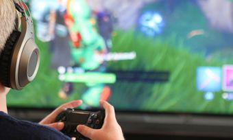 Boy playing Playstation 5