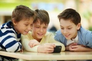 Boys using smartphone