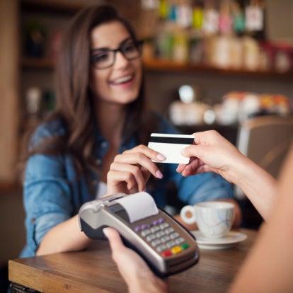 Woman paying coffee