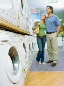 Couple washing machine shopping